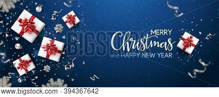 Merry Christmas And New Year Text On Blue Holiday Background With Red Gift Boxes, Silver Fir Branche