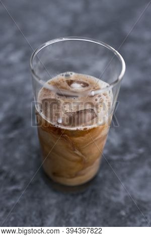 Cold Brew Iced Vanilla Latte Coffee In Tall Glass With Ice On Concrete Background