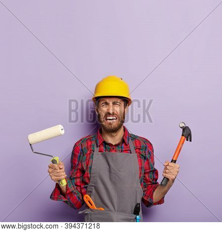 Dejected Crying Foreman Tired Of Mannual Work, Holds Building Tools, Looks With Desperate Expression