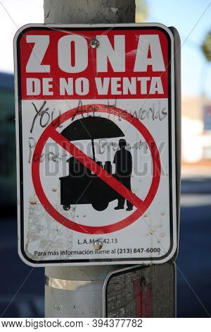 West Hollywood, California /USA - November 10, 2020: No Soliciting Sign on a light pole. City Ordnance does not allow Street Vendors or Solicitors.  Editorial Use Only