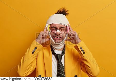Photo Of Funny Man Has Head Injury, Bruises Under Eyes After Falling From Height, Keeps Hands On Tem
