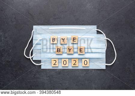Text Bye Bye 2020 On Medical Mask On Dark Stone Background - Image