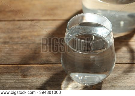 Glass Of Water On Wooden Table, Closeup With Space For Text. Refreshing Drink