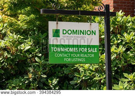 Port Coquitlam, Canada - July 13,2020: A Sign Of New Townhouse Development