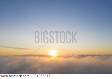 Aerial View Gold Sunrise Over Clouds In Blue Sky. Aerial Top View Cloudscape. Texture Of Clouds. Vie