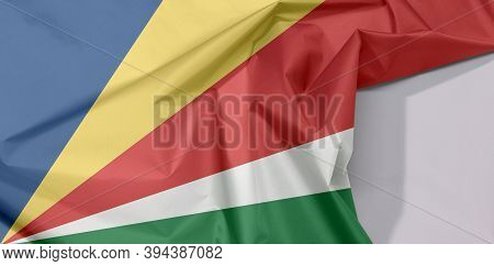 Seychelles Fabric Flag Crepe And Crease With White Space, Five Oblique Bands Of Blue Yellow Red Whit