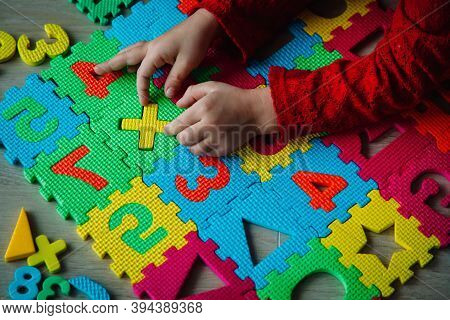 Little Girl Playing With Puzzle, Education Concept