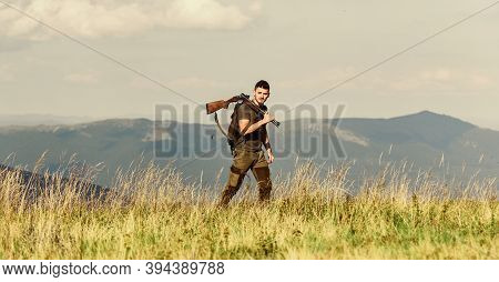 Man Brutal Gamekeeper Nature Landscape Background. Walking In Mountains. Hunting Masculine Hobby Con
