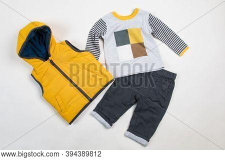 Composition With Fashionable Children Clothes. Ttrendy Kids Clothes. Kids Fashion