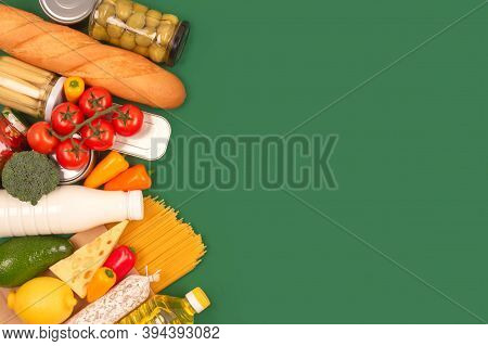 Different Groceries, Food Donations On Green Background With Copyspace - Pasta, Fresh Vegatables, Ca