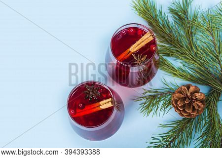 Christmas Mulled Red Wine With Spices On Blue Background. Cranberry Drink With Cinnamon And Anise. M