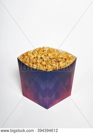 Box Of Popcorn On A White Background. Popcorn With Caramel For Cinema And Movie, Isolate
