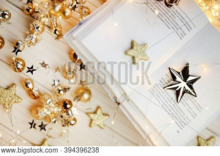 Winter Books.winter Cozy Reading. A Pile Of White Books, Shining Stars And Garlands On A White Woode
