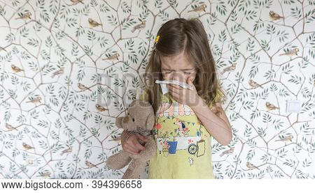 The Child Is Allergic To Pollen And Allergic To Animals, So He Sneezes In A Handkerchief. The Child