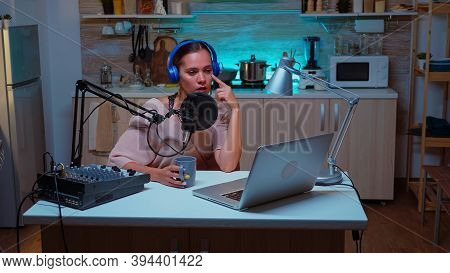 Online Star Show Recording Podcast Wearing Headphones And Talking On Professional Microphone. Creati