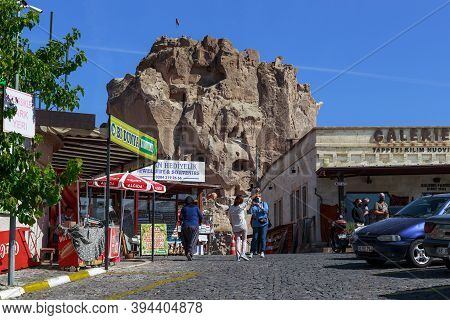 Uchisar, Turkey - October 4, 2020: This Tuff Rock With Cave Passages Cut Into It At The Highest Poin