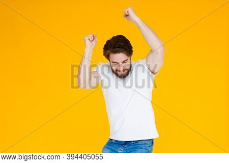 Laughing Young Bearded Man Posing Isolated On Yellow Orange Background Studio Portrait. People Emoti