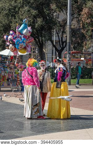 Barcelona, Spain - Feb 24, 2020: 3 Street Artists Chatting On Plaza De Catalunya