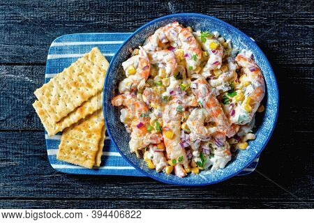 Shrimp Salad With Sour Cream Dressing, Corn, Red Onion, And Parsley Served On A Blue Salad Bowl With