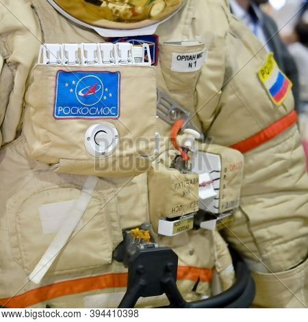 The Spacesuit Of A Russian Cosmonaut From The Iss Space Station. Roscosmos Inscription On The Astron