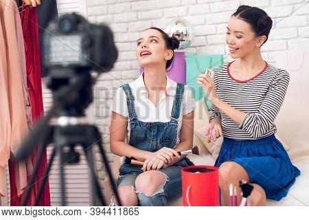 Two Fashion Blogger Girls Spray Parfume To Camera.
