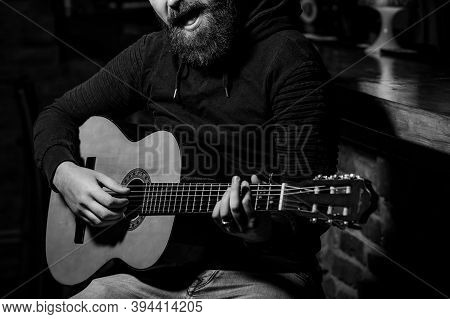 Bearded Guitarist Holding An Acoustic Guitar. Talented Romantic Person Singing Song.