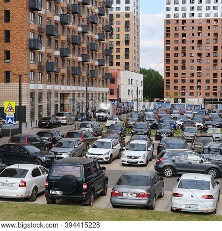 Cars Are Parked In The Parking Lot Near The Unfinished New Building - Moscow, Russia, August 20, 202