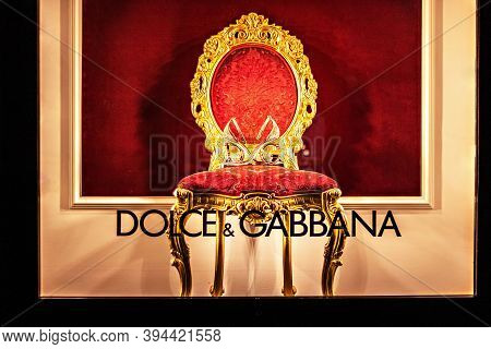 Moscow / Russia-december 2019: Gold Womens Shoes On A Red Velvet Chair, In A Classic Style. The Insc