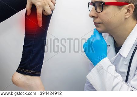 The Woman Suffers From Pain In The Calf Mouse. Knee Treatment Concept For Trauma, Myositis, Nerve Da