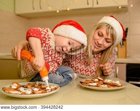 Funny Child Prepare Holiday Food For Santa Clause. Cute Boy Bake Homemade Festive Gingerbreads. Sant