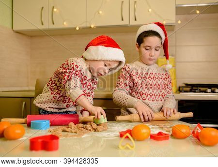 Funny Children Prepare Holiday Food For Family. Santa Kids Making Cookie For Santa In Cozy Kitchen.