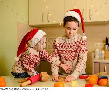 Funny Kids Making Cookie For Santa In Warm Kitchen. Santa Chefs. Beautiful Boys Bake Homemade Festiv