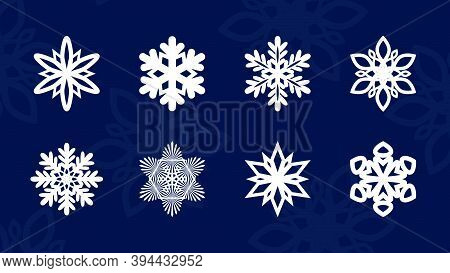 Set Of Vector Snowflakes. White Snowflake Vector Icon Set On Blue Color Background . Christmas Winte