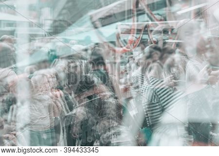 Abstract Blurred Large Crowd At A Trade Fair, Walking In The Shopping Center, Unrecognizable People,