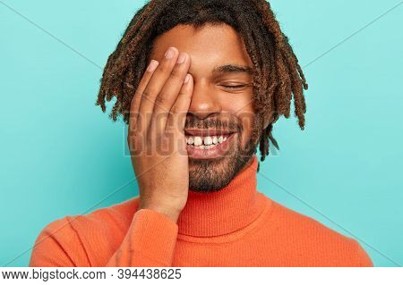 Close Up Portrait Of Happy Pleased African American Man Smiles Broadly, Has White Teeth With Little