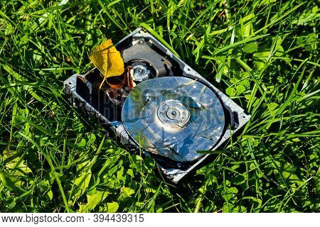 Crushed Hard Disk Drive On The Grass Closeup