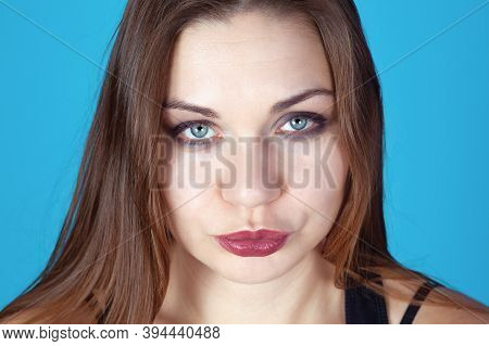 Close Up Portrait Of Young Beautiful Woman With Light Skin, Dark Hair And Blue Eyes, With Smokie Mak