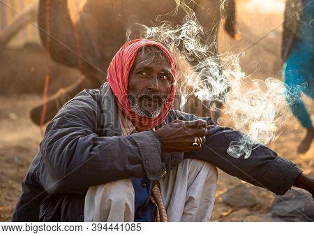 November 2019 Pushkar,rajasthan:portrait Of A Man Smoking Bidi At Pushkar Festival,india.