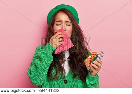 Unhappy Brunette Girl Suffers From Flu Symptoms, Rubs Nose With Handkerchief, Has Cold, Holds Pills,