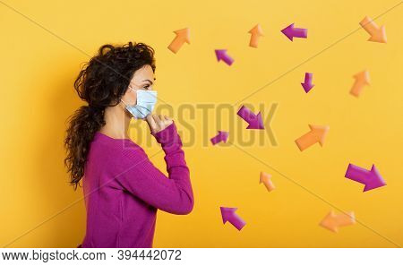 Girl With Face Mask Is Undecided About The Arrow To Follow. Concept Of Covid-19 Confusion. Yellow Ba