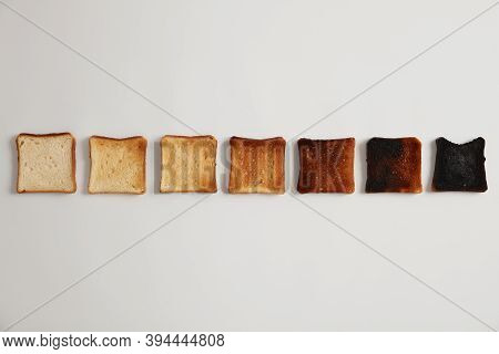 Tasty Toasted Slices Of Bread From Unroasted To Burnt. Stages Of Toastiness. Selective Focus. Crusty