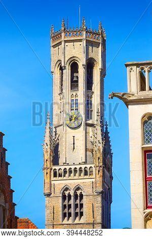 Bruges Or Brugge, Belgium Belfry Tower Aka Belfort And Traditional Narrow Street