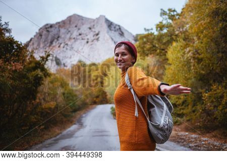 Outdoor Fashion Photo Of Young Beautiful Lady Surrounded Autumn Forest In Mountains
