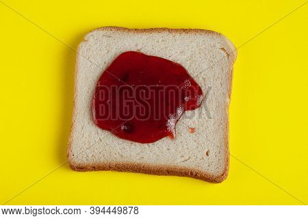 Fresh Delicious Slice Of Toast Bread With Strawberry Jam On A Yellow Background