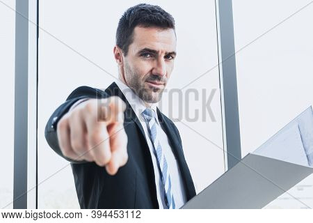 A Businessman Is Pointing The Finger To Command Work With An Office Worker. The Boss Is Pointing A F