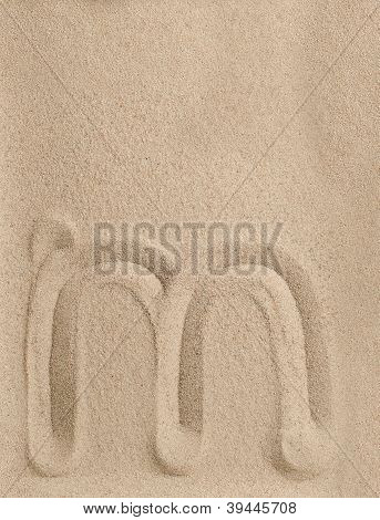 Letter m from sand