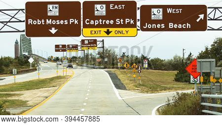 Driving On The Robert Moses Causeway Looking At The Birdge To The Beach With Signs Directing You To