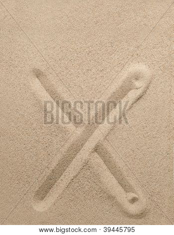 Letter x from sand