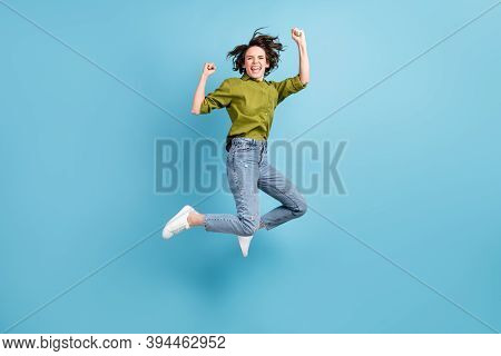 Photo Portrait Of Crazy Ecstatic Woman Jumping Up Celebrating Fists In Air Isolated On Pastel Light