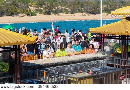 China, Hainan Island, Sanya - January 21,2020: Worshippers Presented Incense Sticks And Pray In Fron